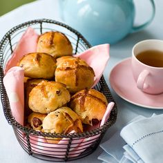 We've put a couple of twists on the traditional hot cross bun recipe by adding apple, cranberries and a marzipan centre.