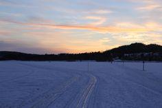 Sunset on ice. Vinterparken in Östersund, Jämtland, Sweden.