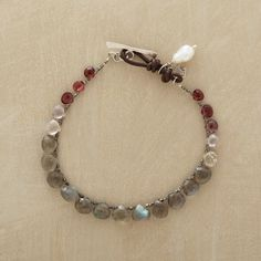 """DIVINE DROPLET BRACELET--Naomi Herndon showcases sparkling red spinel, labradorite and moonstone briolettes on oxidized sterling silver chain, adding a cultured keishi pearl to the leather loop and sterling silver toggle closure. Handcrafted exclusively for Sundance. 7-1/2""""L."""