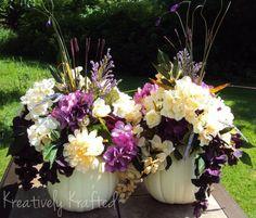 pumkin centerpieces for weddings | Cream and purple colored wedding pumpkin centerpiece arrangements.
