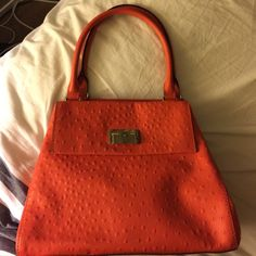 Faux Ostrich Kate Spade Faux Ostrich leather. Barely used with clean interior. Front of the bag has hidden pocket (see photo). Back of the purse has a few wrinkles (see photo). Comes with original dust bag. kate spade Bags