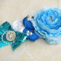 Beautiful Spring Blue Rosette Flower headband. This piece is one of a kind created by Bowtastic Boutique. Perfect for any color blue outfit. Good for any age. Lace headband accessorized with pearls, Rhinestones