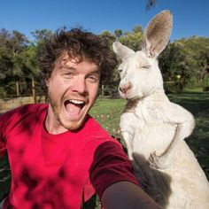 This guy is the master of taking cool selfies with animals