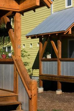 Corrugated Metal, timber framing, slanted roof, 1/2 walls, raised deck.  Yep; perfect.