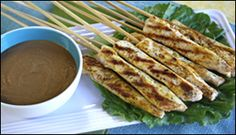 HG's Hip-Hip-Hooray Chicken Satay    Serving Size: 2 skewers with sauce  Calories: 109  Fat: 2.75g  Sodium: 269mg  Carbs: 4.5g  Fiber: 0.25g   Sugars: 2g   Protein: 15.5g