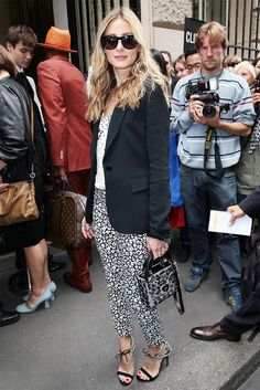 Olivia Palermo dons leopard print slim ankle pants effortlessly with a simple black blazer and killer shades to boot.
