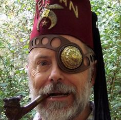 Check out this Steampunk fez (shriner's style) with a fantastic bronze and leather eyepatch, and a funny pipe fit for a hobbit.