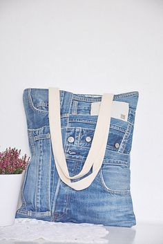 STYLISH denim tote bag with pretty floral cotton lining + one denim pocket on the inside. Made from high quality blue jeans (recycled - upcycled) with great attention to detail and passion for sustainable living. Handmade in UK. Ideal for smart-casual look or everyday use. Materials