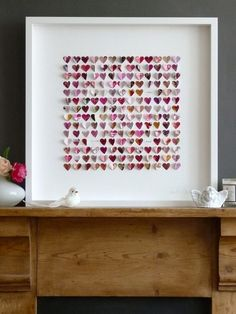 art idea: cut out little paper hearts out of colored paper or old magazine pages then string them/ glue them together on a white sheet and frame it in a minimalistic white frame. LOVE.