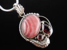 New addition to our shop! Use code SAGEINSPIRATIONS10 for a 10% discount at checkout. Rhodochrosite & Garnet Sterling Silver Pendant/Necklace - $129.00