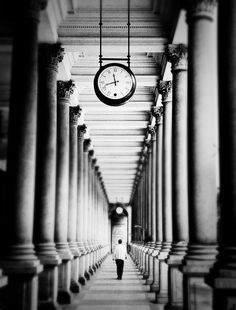 Perspective/Repetition.  Our eyes like repetition, especially when presented in a perspective format.  This image of an individual walking between pillars perfectly embodies this design concept.