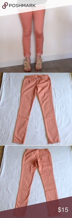 American Rag Peach Skinny Jeans The pictures don't do justice for these jeans! American Rag skinny jeans. Complete the look rolled up with sandals and a white top. Like new. Size 5R. Some stretch. American Rag Jeans Skinny