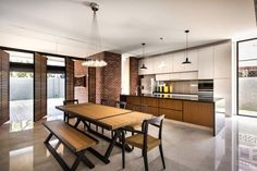 Rustic but casual kitchen and dining area with a bench around the wooden table to encourage interaction.