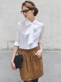 I love this look and I have about 3 vintage patterns with this type of blouse. Seriously. I need to sew already.
