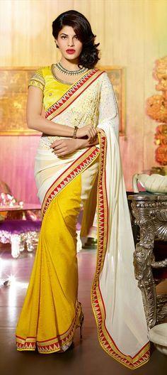 Yellow n white embroidered saree