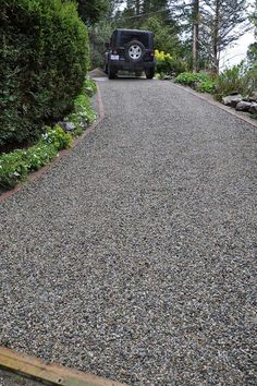 The CORE System retains the gravel and ends rutting and sinking on a gravel driveway. It is also weed free and allows for landscaping right up to the driveway's edge.