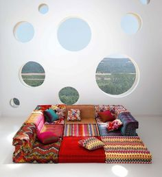 Mah-Jong by Roche Bobois. Missoni Home covered the seat in their iconic zigzag stripe patterns