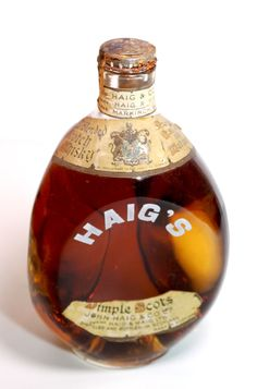 Dimpled bottle of Haig's Scotch Whiskey 1936, from the reign of George V. we know this from the labels to the top of the bottle and also the metal cap is intact with a label across the cap unopened...Rare in this very fine condition. Highly Collectable. 1936. over 78 years old.