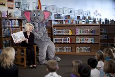 Callista Gingrich, wife of Republican presidential candidate, former House Speaker Newt Gingrich, reads to children at Chaparral Elementary School as Ellis the Elephant, a character from her book, watches Wednesday, Feb. 22, 2012, in Gilbert, Ariz.