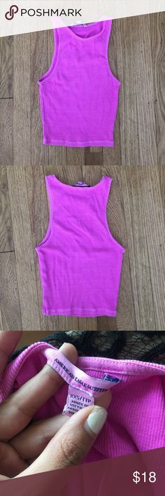 Neon purple/fuchsia crop top American Eagle Neon purple/fuchsia crop top American Eagle. Great with high waisted jeans or shorts. American Eagle Outfitters Tops Crop Tops
