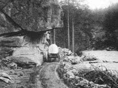 Just two ruts and a covered wagon illustrate the nature of the Riley Road up the Big Thompson Canyon.