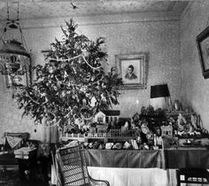 Christmas tree and miniature village in parlor of Harry C. and Hulda Seele, 433 E. Crockett Street, San Antonio, Texas, circa 1900. (UTSA Libraries Special Collections)