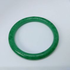Vintage jade colour costume bangle  Great condition with slight natural imperfections  *We aim to sell items in the best possible condition, however most of our stock is vintage and therefore secondhand and may have some signs of wear. Any major flaws will be noted in description and highlighted in photos to the best of our ability*