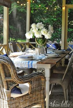 Farmhouse table with metal chairs and wicker end chairs