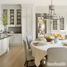 Vary the finishes when you have an all-white palette in your kitchen. If your cabinets have a high sheen, then hone the countertops.