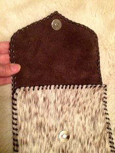 Suede lining in the mini iPad case. See gowestdesigns.us for all kinds of cowhide purses, totes, diaper bags and much more.  Custom orders welcome.