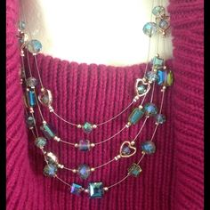 Illusion rhinestones set. Beautiful turquoise crystals and rhinestones. an elegant and multi strand wire necklace. Comes with matching earrings. Brand new. 16.9*0.81 inch. None Jewelry