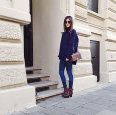 Street Style wearing Céline oversize knit sweater, skinny jeans from Golestaneh Fashion Store, Acne Track boots, Chanel Boy bag