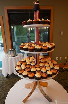 This is a really cute hockey wedding cupcake tower.  Definitely a doable DIY project using old hockey sticks as the base.