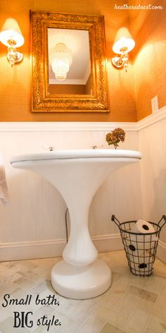 Small bathrooms need not lack BIG style.  Check out this little powder room renovated on a little budget renovation, complete with Craigslist pedestal sink!  Score!