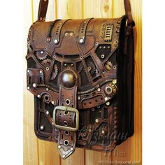 """geekygeekweek: """" Stunning Steampunk Leather Bags And Books These bags and books are the work of Russian leatherworker and throat singer Serguei Kooc. He's created incredibly detailed Steampunk bags and books with lots of brass accents. Moda Steampunk, Design Steampunk, Costume Steampunk, Style Steampunk, Steampunk Couture, Victorian Steampunk, Steampunk Clothing, Steampunk Fashion, Steampunk Bags"""