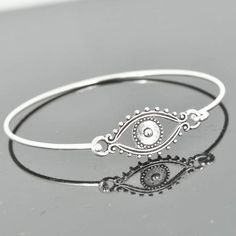 A personal favorite from my Etsy shop https://www.etsy.com/hk-en/listing/211487656/evil-eye-bangle-sterling-silver-bangle