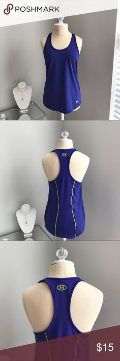 Under Armour Tank Top Under Armour heatgear tank top. Heatgear helps you stay dry and comfortable. Tank is a purple blue, but it is definitely more purple than it looks in the photos, with neon green detail.  Good condition!                       •n o  t r a d e s• •s m o k e  f r e e / p e t  f r e e  h o m e•   •s a m e / n e x t  d a y  s h i p p i n g• Under Armour Tops Tank Tops