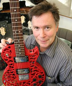 Olaf Diegel Massey University's School of Engineering and Advanced Technology with samples of 3D-printed electric guitars