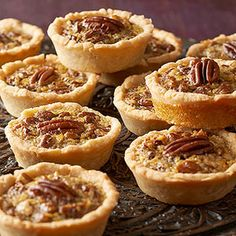 Mini Maple Pecan Pies Recipe Desserts with reduced fat cream cheese, vegetable oil, all-purpose flour, eggs, sugar, pure maple syrup, vegetable oil, vanilla, chopped pecans, pecan halves