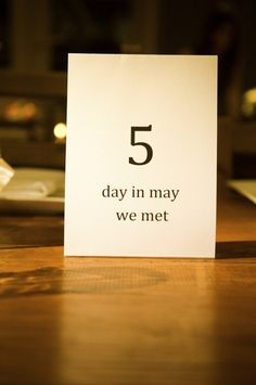 oh such a cute idea for table numbers - using ones that are significant to the couple, and letting everyone wait until theyre seated to find out what it means...this is cute, but I also like the idea of photos with the bride and groom doing various activities.  Were an active couple so that would work for us
