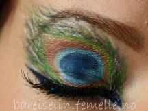 peacock; pretty but I wouldn't do it quite so literally maybe just like half of the feather so you get the cat eye effect :) Cool idea!