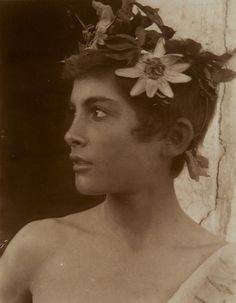 Sicilian girl with a wreath of passion flowers.ca 1900  Photography: Wilhelm Von Gloeden