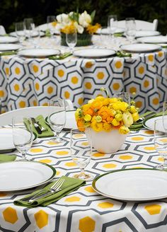 This bright and sunny outdoor celebration is sure to put a smile on your face. Happy hues of yellows, greens and whites truly make this outdoor setup sing.