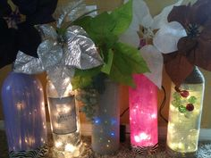 more wine bottles with lights that were inserted through a small hole I drilled at the bottom, used glass paint, burlap and dollar store flowers.
