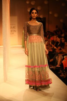 Sheer is totally IN. Pretty ensemble of plain blouse so earthy attached sleeves in lace. Sheer skirt with pink borders running on the bottom of the skirt. Manish Malhotra | LakmeFashionWeek2013