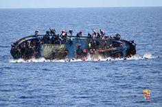 """Migrants are seen on a capsizing boat before a rescue operation by Italian navy ships """"Bettica"""" and """"Bergamini"""" off the coast of Libya in this handout picture released by the Italian Marina Militare on May MUST CREDIT: BEST IMAGE/DIIMEX. Shiga, Refugee Boat, Refugee Crisis, Spiegel Online, Pictures Of The Week, Shipwreck, Mediterranean Sea, Bratislava, Boats"""