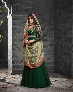 Dark Green Net Party Salwar Kameez - SKMOHI49005 Dark Green Georgette Anarkali Salwar Kameez with Thread and Zari Embroidery. Extremely Desirable Style Ethnic Anarkali Suit with Bottom of Santoon Fabric. Comes with a matching Net Dupatta.