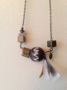 Bronze, wood, stone, deer hide and feather. Asymmetric, geometric necklace. www.etsy.com/shop/MegaDesign
