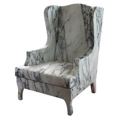 Louis XV goes to Sparta, this chair may look stiff and uninviting, but in reality it is made of materials that ensure comfortable seating