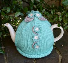 I have created this pretty turquoise hand knitted tea cosy with crocheted forget-me-not flowers using a lovely aran yarn. The flowers are crocheted with turquoise cotton and have cream centres. There are three grey knitted leaves attached. Hand Knitting, Knitting Ideas, Autumn Tea, Mug Cozy, Tea Cosies, Cozies, Pretty Hands, Flower Tea, Cosy